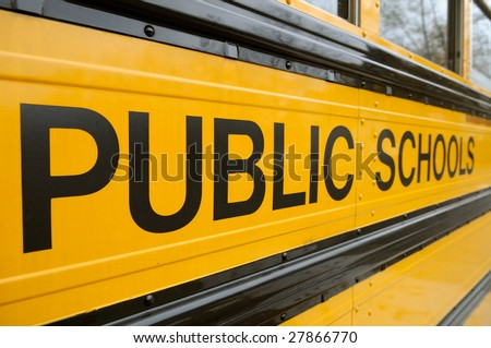 Public School sign detail on school bus - stock photo