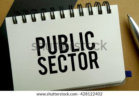 Public sector memo written on a notebook with pen - stock photo