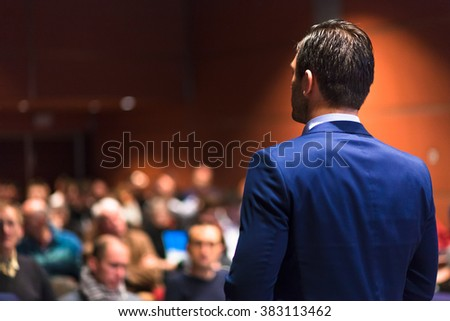 Public speaker giving talk at Business Event. - stock photo