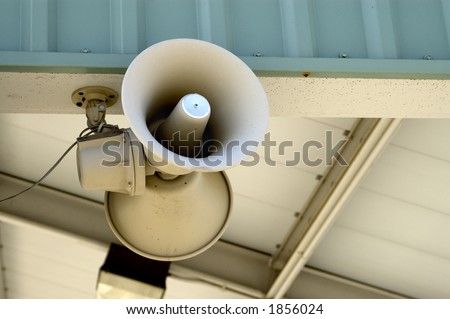 Public speakers at a train station. - stock photo