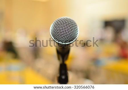 Public speaking at Lone Microphone - stock photo