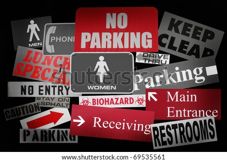 public street sign collection with black and white and red