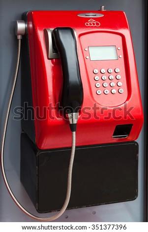 public telephone on a city street - stock photo