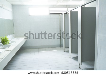Bathroom Stall Office toilet stall stock images, royalty-free images & vectors