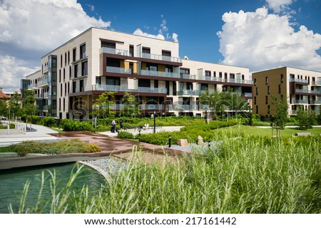 Public view of eco friendly block of flats in the green park with blue sky with few clouds - stock photo