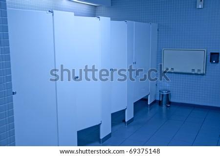 Public washroom stall with blue tone - stock photo