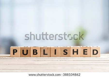 Published sign on a wooden table in a room - stock photo