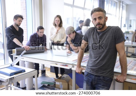 Publisher advertising agency owner working with team on a creative project. - stock photo