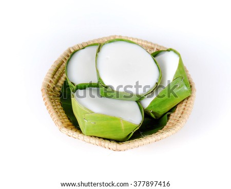 pudding with coconut topping in bamboo baskets isolated on white background.