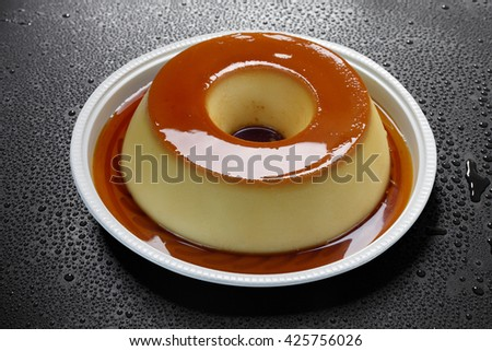 Pudding with milk and eggs with syrup - stock photo