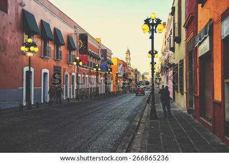 PUEBLA DE ZARAGOZA, MEXICO - MARCH 16, 2011: Morning streets in the one of the five most important Spanish colonial cities in the country. Famous history and architectural styles. - stock photo