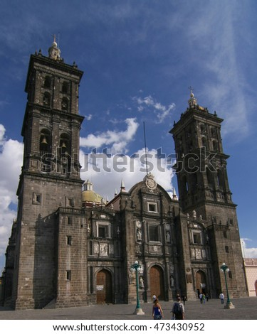 PUEBLA, MEXICO - February 22, 2008: Roman Catholic colonial Cathedral during the day - consecrated in 1649. It is a major landmark in the city. Clear blue sky, unidentified people