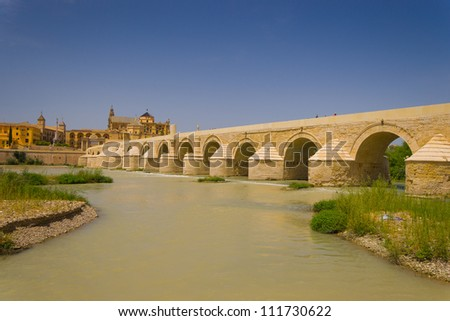 Puente Romano Is the old roman bridge that give acces to the city Cordoba - stock photo