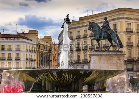 Puerta del Sol Gate of the Sun Most Famous Square Fountain King Carlos III Equestrian Statue in Madrid Spain King of Spain in the 1700s.  Replica of statue created in 1700s by Juan Pascal de de Mena - stock photo