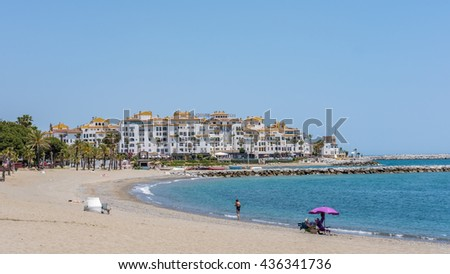 PUERTO BANUS ANDALUCIA/SPAIN - MAY 26 : View of the Beach at Puerto Banus Spain on May 26, 2016. Unidentified people - stock photo