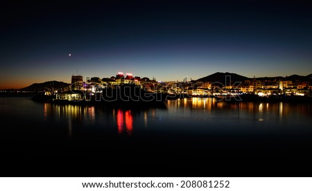 Puerto Banus in Marbella, Spain at night. Marbella is a popular holiday destination located on the Costa del Sol in the southern Andalusia, it lies beneath the Cordillera Penibetica mountains  - stock photo