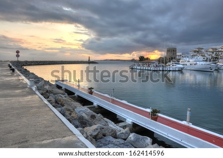 Puerto Banus surprised at sunset. Puerto Bano is an exclusivist port from Costa del Sol, surrounded by luxury restaurants and stores. It is of the largest entertainment centres in the Costa del Sol. - stock photo