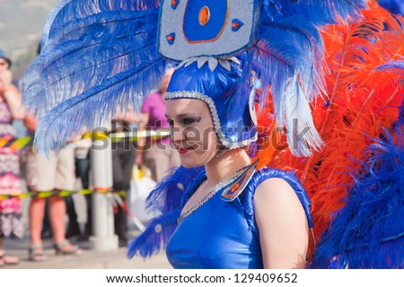 PUERTO DE LA CRUZ, SPAIN - FEB 16: unidentified participants prepare and assemble for the main carnival parade on February 16, 2013 in Puerto de la Cruz, Tenerife, Spain