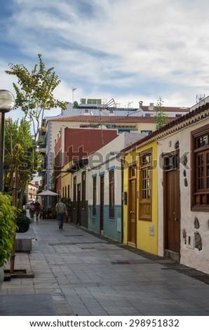 PUERTO DE LA CRUZ, TENERIFE, CANARY ISLANDS - JANUARY 14, 2014: Beautiful buildings in the old town of Puerto De La Cruz, one of the most popular touristic towns on Tenerife, Canary islands, Spain - stock photo
