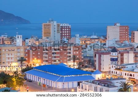 PUERTO DE MAZARRON, SPAIN - MAY 13: View over the town Puerto de Mazarron illuminated at dusk. May 13, 2015 in Puerto de Mazarron, Murcia Province, Spain - stock photo