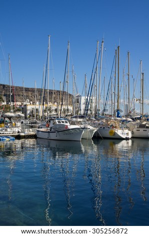 PUERTO DE MOGAN, GRAN CANARIA, CANARY ISLANDS - JANUARY 04, 2014: Yachts in harbor of Puerto de Mogan, a small fishing port and resort on Gran Canaria Island, Spain - stock photo