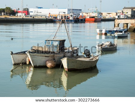 PUERTO DE SANTA MARIA, SPAIN JULY 6, 2015: Fishing boats on Guadalete river in Puerto de Santa Maria, Andalusia, Spain. Puerto de Santa Maria is famous for great fish & seafood.