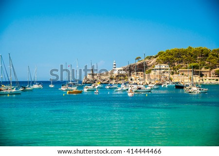 Puerto de Soller, Port of Mallorca island in balearic islands, Spain. Beautiful picture of boats in clear blue water of bright summer day. - stock photo