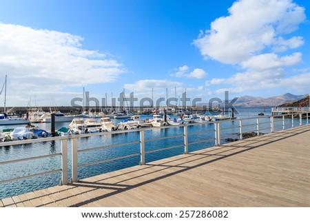PUERTO DEL CARMEN, LANZAROTE ISLAND - JAN 17, 2015: promenade in Puerto del Carmen port on sunny day. Canary Islands are popular holiday destination due to warm climate. - stock photo