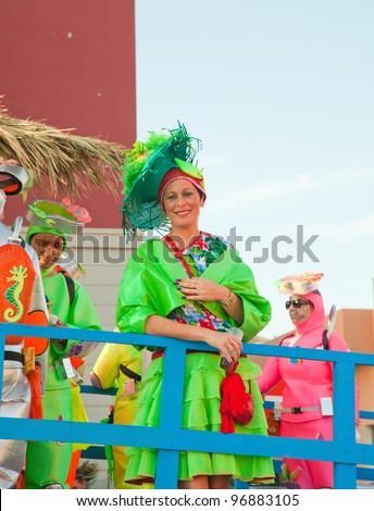 PUERTO DEL ROSARIO, SPAIN - FEBRUARY 25: Young woman in elaborate colorful costume takes part in carnival parade  at annual Carnival on February 25, 2012  in Puerto del Rosario, Fuerteventura, Spain