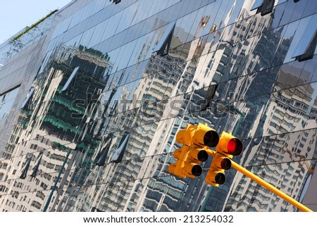 Puerto Madero Waterfront in Buenos Aires - traffic light and reflection in the glass business skyscrapers buildings - stock photo