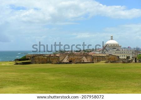 Puerto Rico Capitol (Capitolio de Puerto Rico) and Castillo de San Cristobal, San Juan, Puerto Rico. Castillo de San Cristobal is designated as UNESCO World Heritage Site since 1983. - stock photo