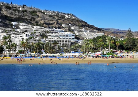 PUERTO RICO, SPAIN - OCTOBER 14: View of Puerto Rico beach on October 14, 2013 in Gran Canaria, Canary Islands, Spain. This is an important winter tourist destination for many europeans - stock photo