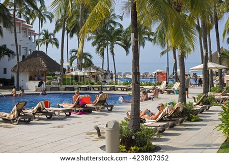 PUERTO VALLARTA, MEXICO -  NOV. 23, 2015: Puerto Vallarta is popular  tourists destination. Beautiful beaches and clear warm water of the North Pacific Ocean are attractive to swimmers all year round. - stock photo