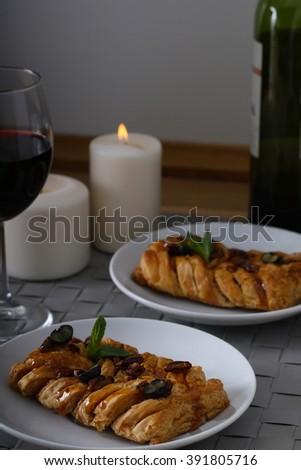 Puff bun with pecan,romantic dinner - stock photo