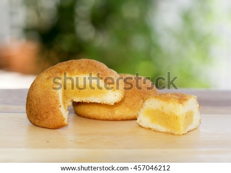 Puff cake and sweet custard cream with bokeh background - stock photo