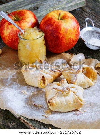 puff pastries with apple jam on the old wooden background - stock photo