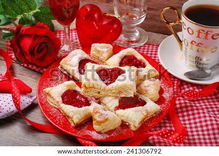 puff pastry cookies with raspberry confiture in heart shape for valentine party  - stock photo