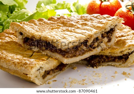 puff pastry pie with minced steak and tomato - stock photo
