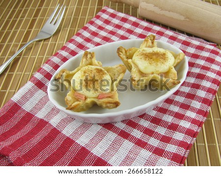 Puff pastry tart with rhubarb, vanilla pudding and cinnamon - stock photo