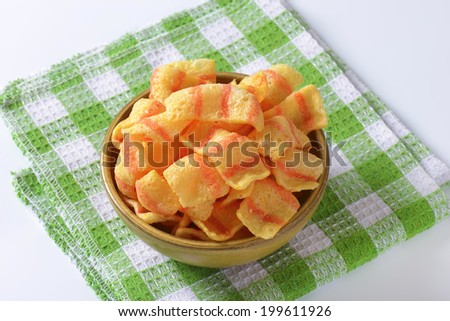 puffed crisps in the bowl - stock photo
