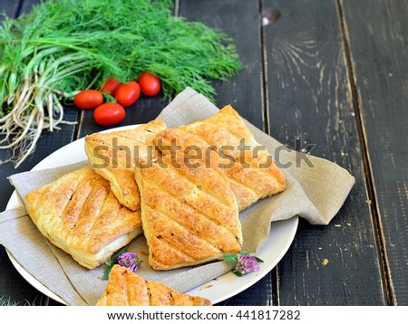 Puffs stuffed with grilled on a dark table - stock photo