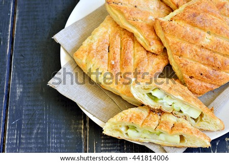Puffs stuffed with grilled zucchini and cheese on a plate isolated - stock photo
