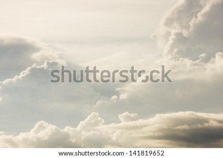Puffy clouds and thunder heads building before storm. - stock photo