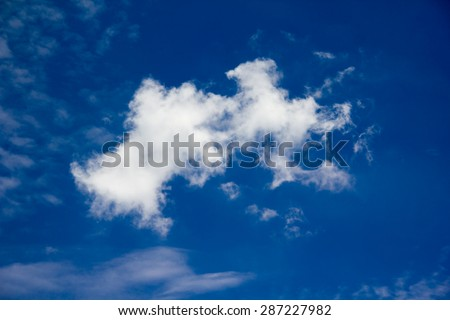 Puffy clouds blue wide dreamy sky background and relax feeling - stock photo