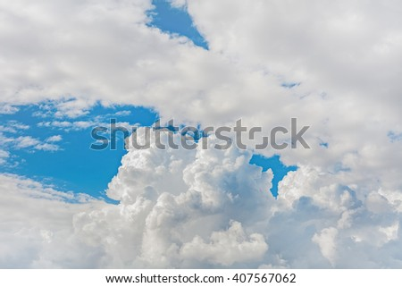 puffy cumulus clouds with blue sky background - stock photo
