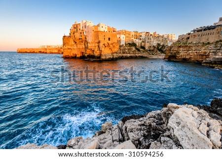 Puglia, Italy. Sunset scenery of Cala Paura beach in Polignano a Mare, town in the province of Bari, Apulia, southern Italia on the Adriatic Sea - stock photo