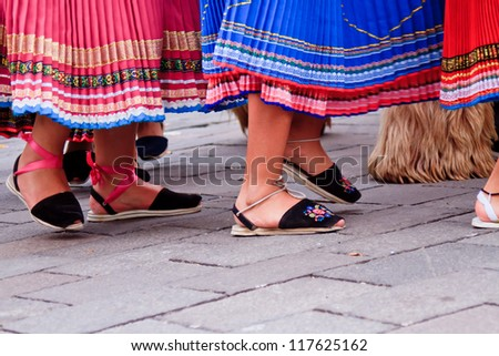 "PUJILI, ECUADOR - 25 JUNE : feet of indigenous women in ""alpargatas"" shoes in traditional costume, Inti Raymi festivities, 25 June 2011 PUJILI, ECUADOR - stock photo"
