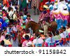 PUJILI,ECUADOR - 25 JUNE : group of men dressed in traditional colorful costumes on the streets of Pujili , Inti Raymi festival celebrated on 25 June 2011 - stock photo