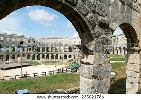 Pula, Croatia - 23 August 2005: tourists walking on the ruins of Roman amphitheatre at Pula on Croatia