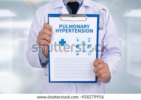 PULMONARY HYPERTENSION Portrait of a doctor writing a prescription
